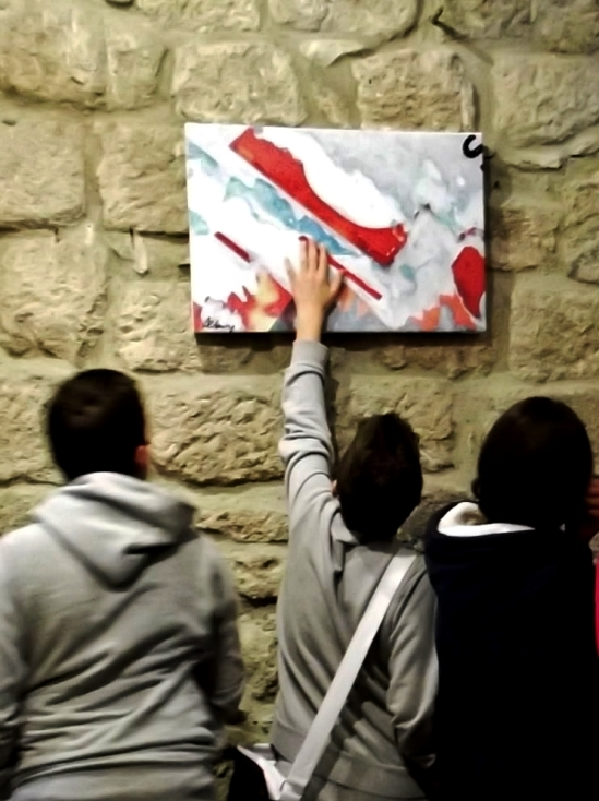 """VOTE IT FOR """"PHOTO-ACTIONS"""". Students visiting Roberto Alborghetti's """"Colors of an Apocalypse"""" exhibition at Aldobrandesca Fortress (XIII Century) in Tuscany (Piancastagnaio, Siena)  Italy"""