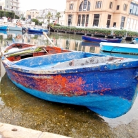 IMAGINARY AUGUST JOURNEY AMONG THE COLORS OF TWO OLD BOATS SEEN IN BARI (ITALY)
